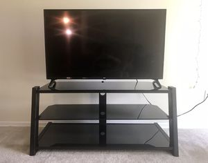 Black glass/metal TV stand (50 inches) for Sale in Alexandria, VA