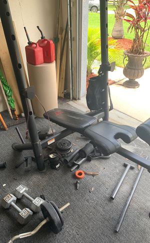 Weight bench with curl bar and weights for Sale in Tampa, FL
