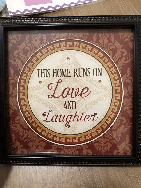 This home runs on love and laughter sign