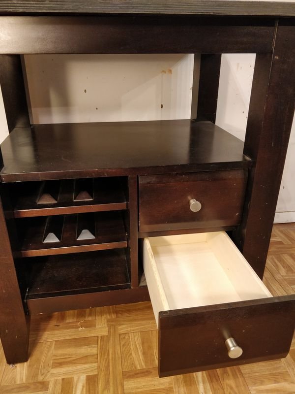 """Nice wooden outdoor/ indoor table with 2 drawers and shelves in good condition. L29""""*W24""""*H33"""""""
