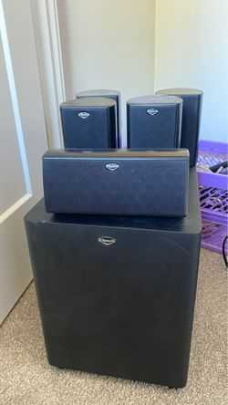 Klipsch 5.1 surround sound speaker system including mounting for front speakers and 2 speaker stands for rear speakers. Upgrade your audio experienc for Sale in Mountlake Terrace,  WA