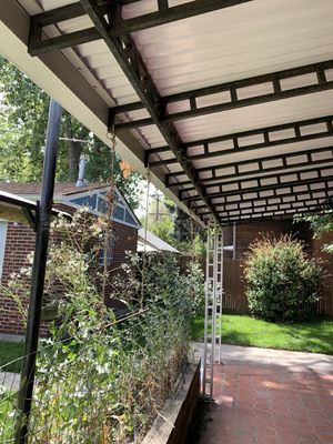 Steel back patio canopy for sale, requires assistance for removal for Sale in Denver, CO