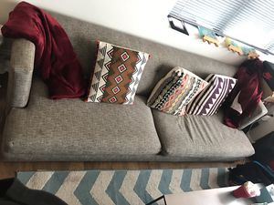 Grey couch, colorful pillows and 2 red throws for Sale in Boston, MA