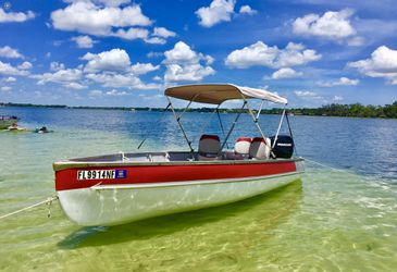 Fiberglass and aluminum 15 footer with 25 hp 4 stroke 2007Mercury new Bimini gas tank battery extinguisher 4 new life jackets, two small anchors and for Sale in Winter Park,  FL