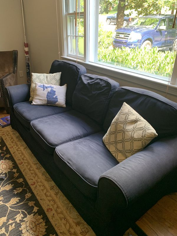 Free! Come get it! Navy couch in fair condition. 84 inches long. Cushion covers are washable and removable.