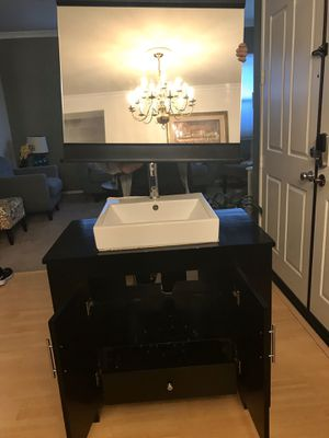 """2 Black Wood cabinet with Lavatory,Faucet,Mirror with wood molding and fixture light Good Condition. measurements 21 1/2 """" Deep, 36"""" Width, 32"""" H for Sale in Palmdale, CA"""