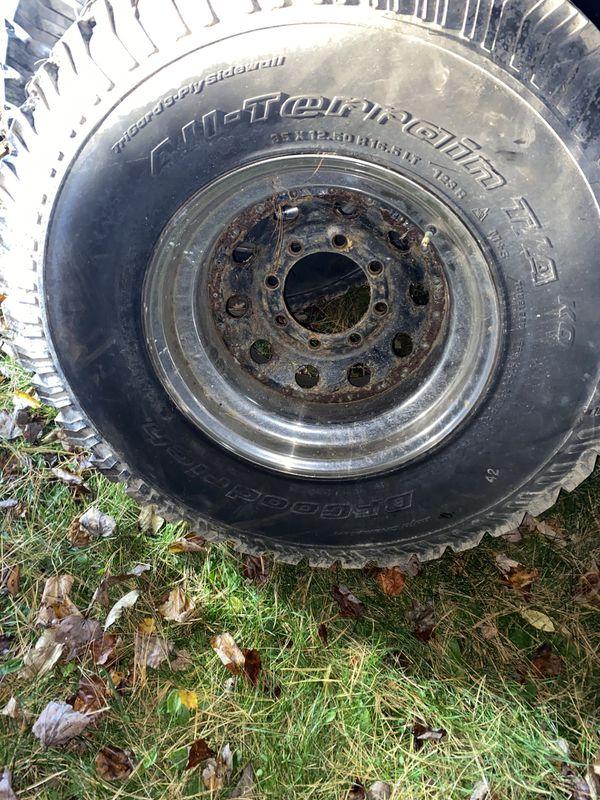 """5 mud tires 16"""" 8 lug chevy rims"""