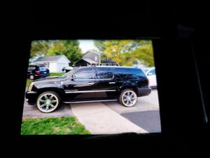"""24 oem Cadillac rims with Vouges . Rims & tires hairs still on for Sale in Hanover Park, IL"