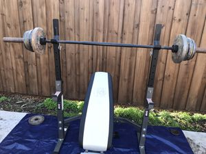 Adjustable bench with separate squat rack, 45lbs barbell and 120lbs of Olympic weight for Sale in Fort Worth, TX