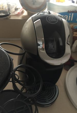 Dolce Gusto Italian coffee maker. Refill coffee (5) canisters and metal black holder. for Sale in Seattle, WA