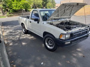 93 Toyota 5 speed manual min truck 200k miles up to date on tags pink in hand/trade for 80s Chevy silverado short bed only. for Sale in San Bernardino, CA