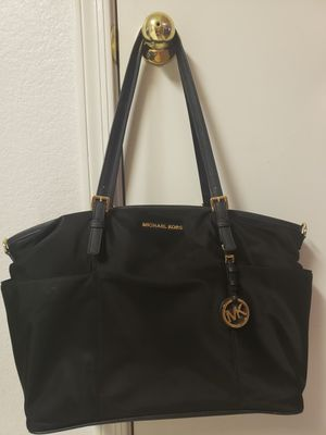 Michael kors diaper bag. Black. 50 Firm for Sale in Glendale, AZ