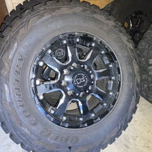 Toyo RT Open Country Tires And 8 Lug Black Rhino Wheels for Sale in Yelm, WA