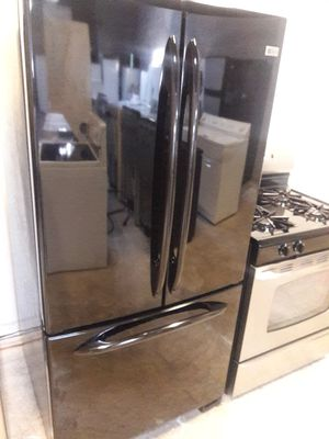 GE 3 doors black refrigerator exellent condition working perfectly clean and neat warranty and deliver for Sale in Halethorpe, MD