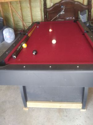 Pool table and sticks an balls for Sale in Pekin, IL