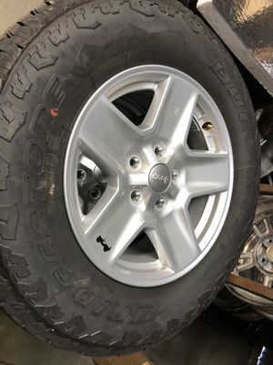 """Jeep 17"""" wheel with Bridgestone Dueler A/T tires like new for Sale in Upland, CA"""