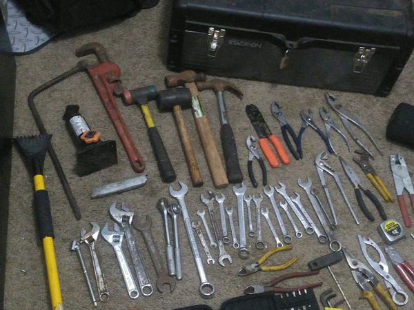 Misc tool lot with hammers, pliers screwdrivers,wrenches, pipe wrench, drill, drill bits, jack, lug wrench and more