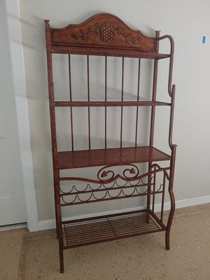 Bakers rack/ wine rack,solid grape wood carvings in good condition. for Sale in Katy, TX