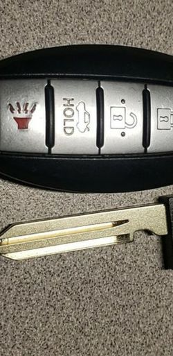 OEM Nisaan key fob with new key for Sale in Fair Oaks,  CA