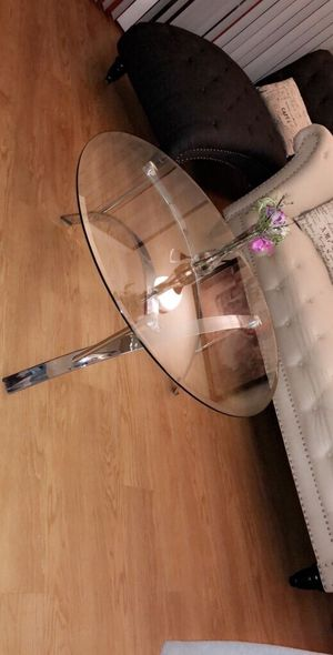 Round stainless steel-based glass-top table for Sale in Alexandria, VA