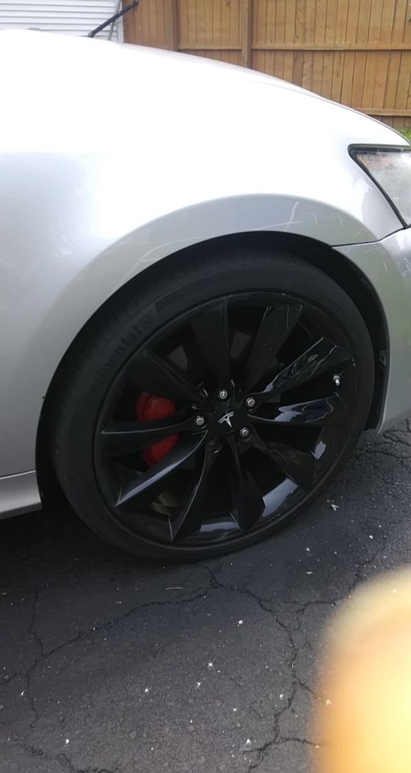 "21"" Tesla rims smoke gray with undriven tires"