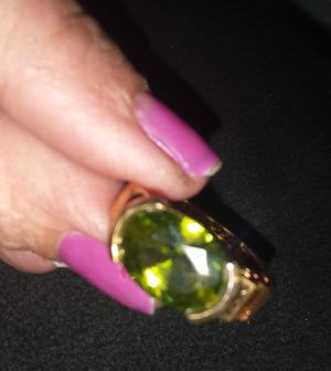 ladies gold colored Peridot ring for Sale in Phoenix, AZ