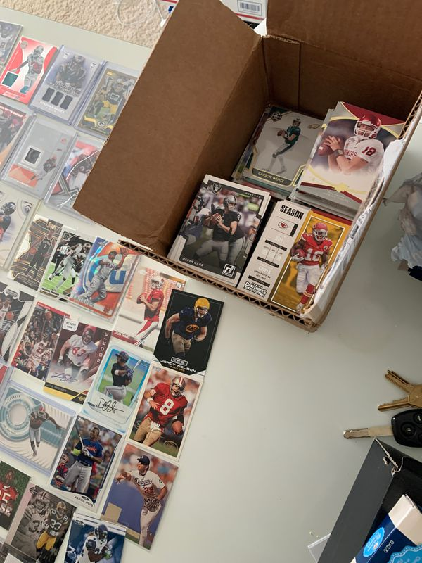 Box full of sports cards football baseball basketball autograph cards jersey cards