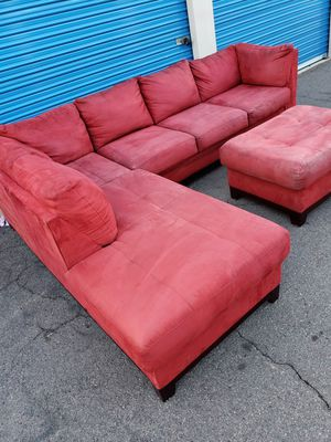 Comfortable sectional couch red with ottoman, for Sale in Glendale, AZ