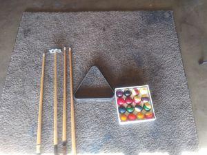 Pool table balls and sticks for Sale in Pico Rivera, CA