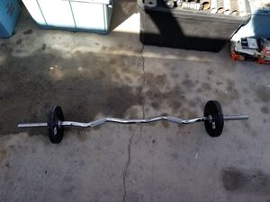 Curl weight bar with 10 pound weight for Sale in Las Vegas, NV