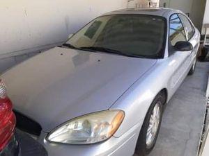 2005 Ford Taurus V6 3.0 L. Runs, new tires, alternator, and battery for Sale in Hemet, CA