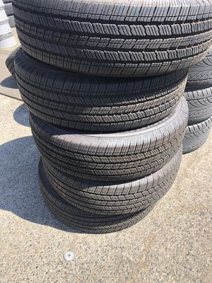 """Almost brand new 17"""" he jeep stock wheels and tires on special for Sale in Fresno, CA"""
