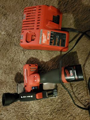 Milwaukee M12 cut off tool with a battery and charger for Sale in Salt Lake City, UT