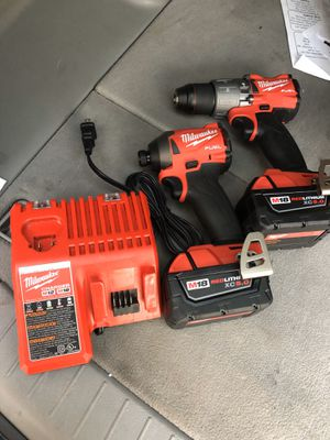 Milwaukee M18 FUEL 18-Volt Lithium-Ion Brushless Cordless Hammer Drill and Impact Driver Combo Kit (2-Tool) with Two 5Ah Batteries for Sale in Houston, TX