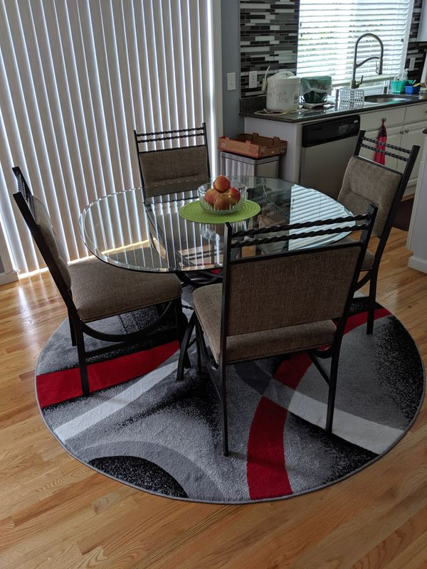 Kitchen Table, Chair and Rug.