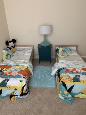 Two toddler beds with protector ,fitted sheets ,blankets , matching curtains for Sale in Silver Spring, MD