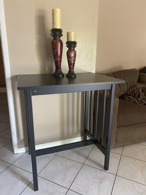 "End table brown size 34"" tall by 32"" wide and 24"" deep for Sale in Garden Grove, CA"