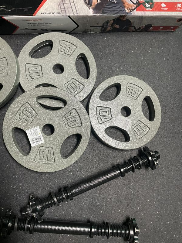 40 Lb Weight Plates For Adjustable Dumbbells And Curl bar. New In Box.