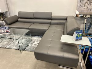 Grey faux leather sofa sectional with adjustable headrest for Sale in Boca Raton, FL