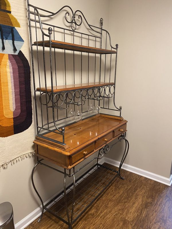 Kitchen Bakers Rack, three drawers, wine bottles with wine glasses. Solid wood, wrought iron.