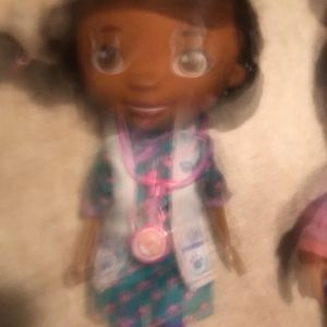 Talking Doc McStuffins things and dance comes with our clothes and approximately 1 1/2 foot tall for Sale in Houston, TX