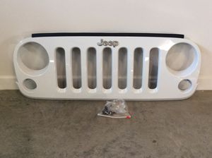 2012 Jeep Sahara Unlimited front grill with attachment parts (stock) for Sale in Hendersonville, TN