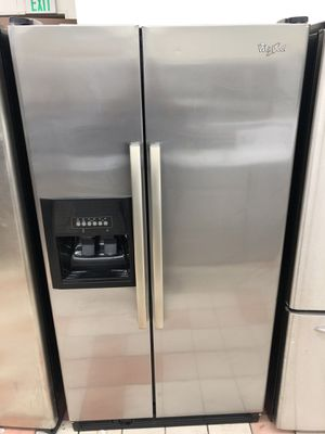 36x70 whirlpool stainless steel refrigerator in excellent working condition 4 months warranty for Sale in Dundalk, MD