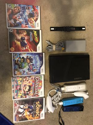 Wii/Wii U Console Only With All Attachments, 2 Controllers Plus 2 Chucks, 8 games for Sale in Escondido, CA