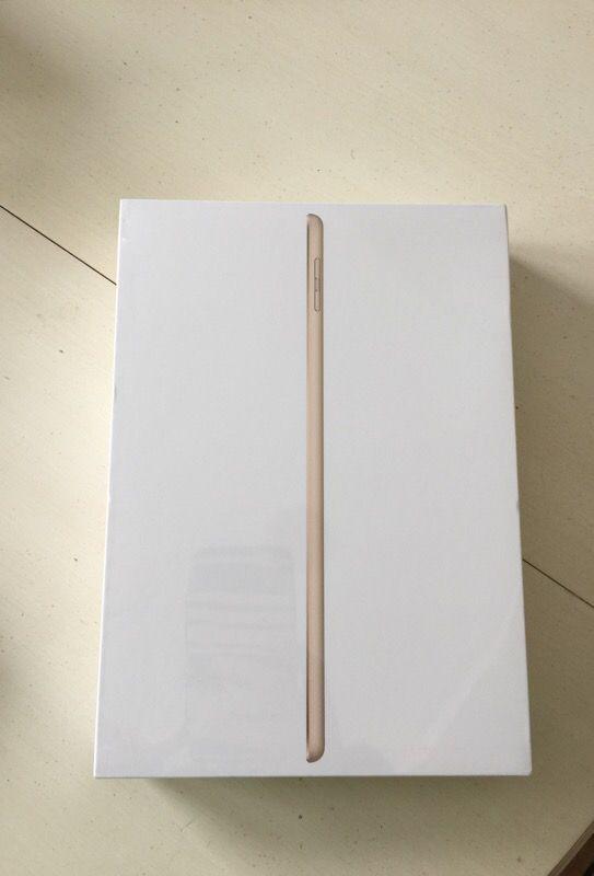 Brand new, never opened, Gold iPad Wi-Fi 128GB