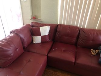 Leather sectional fairly new with ottoman and pillows with the carpet as well just needs cleaned for Sale in Penn Hills,  PA