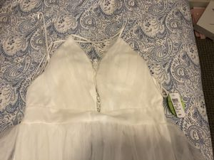 New pretty wedding dress with price tag on it. for Sale in Baltimore, MD