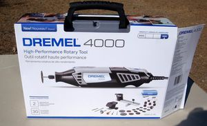 Dremel, dremel and extra parts hole set never used for Sale in O'Fallon, MO
