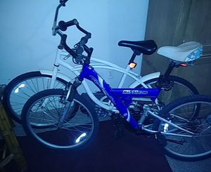 Blue 24 inch kids bike and a 26 inch white Cruiser $80 for Sale in Orlando, FL