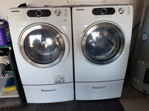 Samsung washer and dryer with pedestals for Sale in New Port Richey, FL